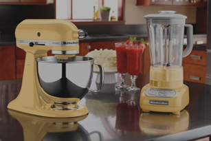 A yellow blender and mixer on a counter